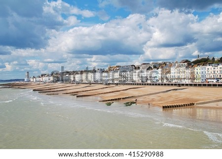 HASTINGS, ENGLAND - APRIL 30, 2016: Looking west along the seafront from the Victorian pier. Closed since 2008, the landmark building reopened to the public on April 27, 2016.
