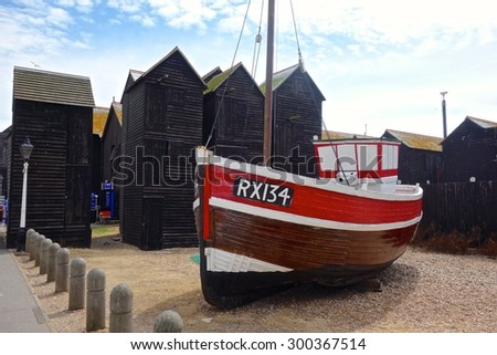 HASTINGS, ENGLAND - JULY 27. A fishing boat and nets located beside the  old fishermen's sail lofts in Hastings are  a popular tourist attraction. July 27 2015 in Hastings, England. - stock photo