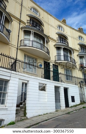 HASTINGS, ENGLAND - JULY 27. This crescent of Georgian houses is located just off the seafront, and is a charismatic part of this seaside town. July 27 2015 in Hastings, England. - stock photo