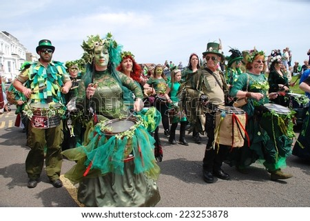 HASTINGS, ENGLAND - MAY 5, 2014: Drummers perform during the parade on the West Hill at the annual Jack In The Green festival. The traditional event marks the May Day public holiday in Britain. - stock photo