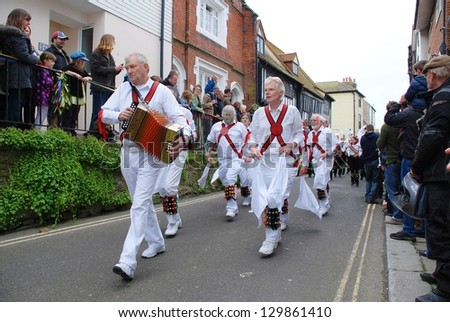 HASTINGS, ENGLAND - MAY 7: Morris dancers perform during a parade at the Jack In The Green festival on May 7, 2012 in Hastings, Sussex. The annual event marks the May Day public holiday in Britain.