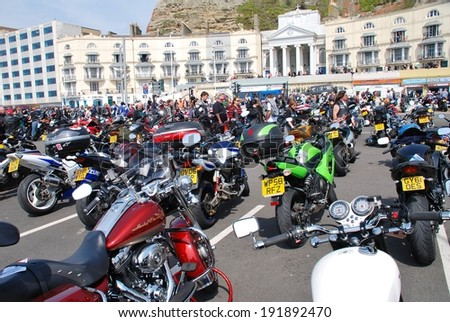 HASTINGS, ENGLAND - MAY 5, 2014: Motorcycles parked on the seafront during the annual May Day bikers rally. Started over 35 years ago, the event is now one of the biggest bike gatherings in the UK. - stock photo