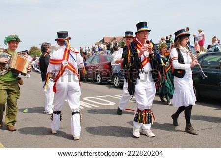 HASTINGS, ENGLAND - MAY 5, 2014: Musicians from Mad Jack's Morris perform in a parade on the West Hill during the annual Jack In The Green festival. The event marks the May Day holiday in Britain. - stock photo