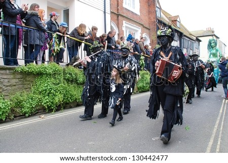 HASTINGS, ENGLAND - MAY 7: Musicians perform during a parade through the Old Town at the Jack In The Green festival on May 7, 2012 in Hastings, East Sussex. The annual event marks the May Day holiday.