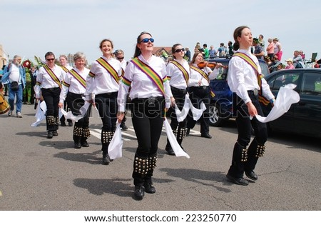 HASTINGS, ENGLAND - MAY 5, 2014: The New Esperance Morris dancers perform during the parade on the West Hill at the annual Jack In The Green festival. The event marks the May Day holiday in Britain. - stock photo