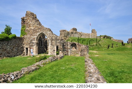 HASTINGS, UK - MAY 17. The ruins of Hastings castle and chapel on May 17, 2014. The site dates from 1067 with a history of  destruction, erosion and World War two bombings at Hastings, Sussex, UK. - stock photo