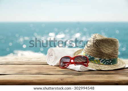 hat and glasses and space for your suntan - stock photo