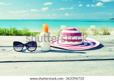 Hat and sunglasses - stock photo