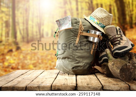hat backpack and shoes and forest of sun light with space for you  - stock photo