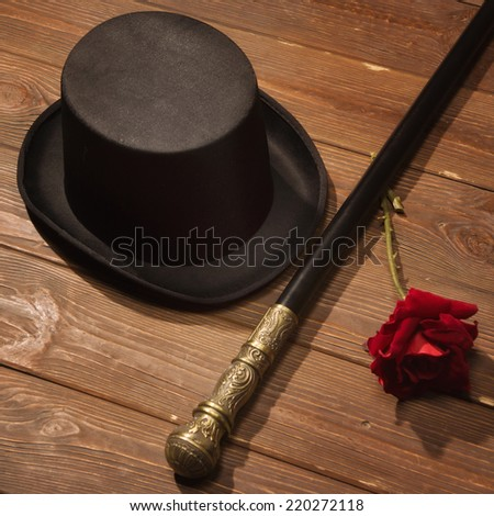 hat, cane and rose on a wooden floor  - stock photo