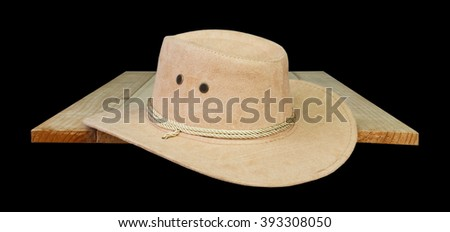 hat cowboy on wood black background.