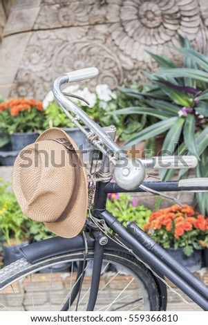 Hat hung on an old bike