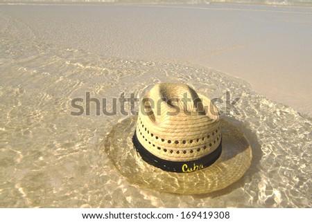 Hat on beach - stock photo