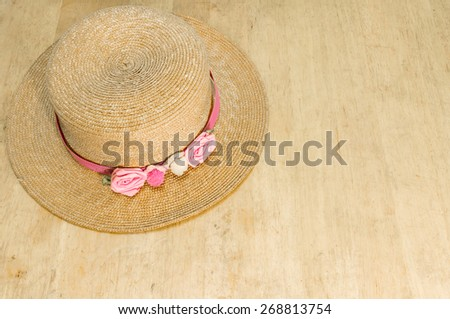 hat on old wood bord - stock photo