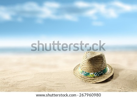 hat on sand and blue sky  - stock photo
