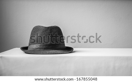 hat on table black and white tone - stock photo