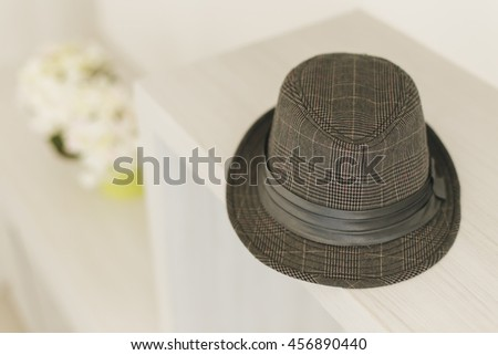 hat on wooden desk in modern living room