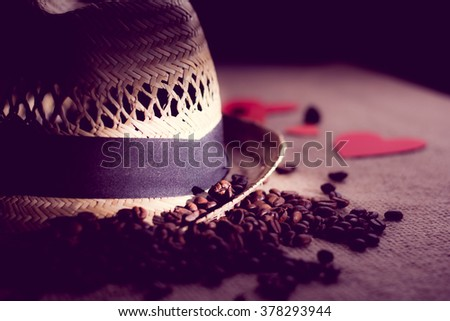 Hat with tape and   freshly roasted coffee beans - stock photo
