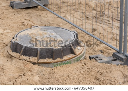 Hatch cover near construction mesh