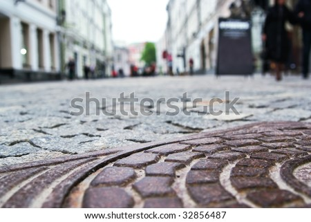 hatch cover on the street - stock photo