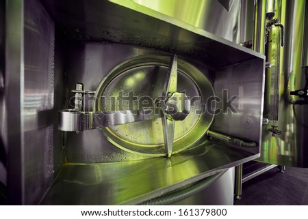 Hatch of beer tank at brewery - stock photo