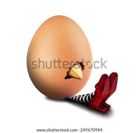 Hatching egg on the wicked witch - stock photo