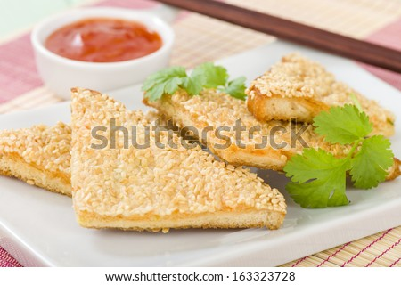 Hatosi (Prawn Toast) - Chinese toasted bread with minced shrimp and sesame seeds served with sweet chili sauce.