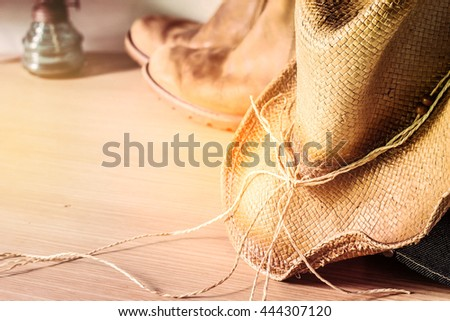 Hats and clothing on a wooden floor. - stock photo