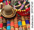 Hats and Colorful Fabric at market in Peru - stock photo