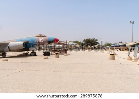 HATZERIM, ISRAEL - APRIL 27, 2015: Multiple types of military jets which served in IAF are displayed in Israeli Air Force Museum in Hatzerim, Israel