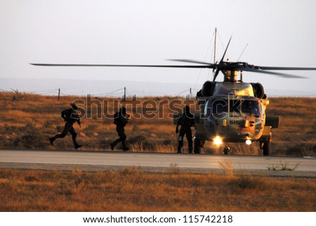 HATZERIM,ISRAEL - JUNE 28 2007: Special forces elite unit 669 is demonstrating its evacuation skills during combat using a UH-60 Black Hawk helicopter at the Hatzerim Air Force in Beer Sheva, Israel. - stock photo