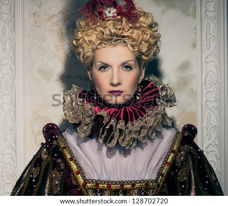 Haughty queen in royal dress - stock photo