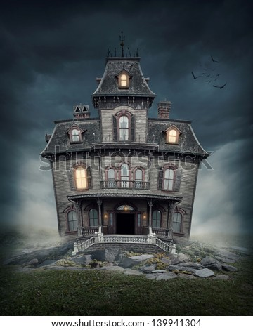 Haunted house on the empty field - stock photo