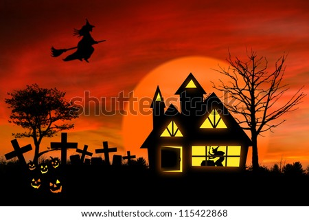 Haunted mansion with Jack O Lantern and spooky graveyard in front of it - stock photo