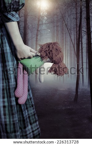Haunted scary forest and a child - stock photo