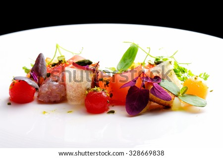 Haute cuisine appetizer with tuna tartare, watermelon and spices - stock photo