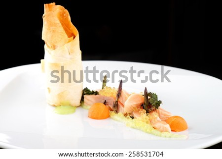 Haute cuisine, pink salmon fillet with caviar and vegetable