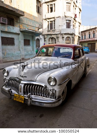 HAVANA-APRIL 15:Classic DeSoto in a shabby neighborhood in Old Havana April 15,2012 in Havana.Before a new law issued on October 2011,cubans could only trade cars that were on the road before 1959 - stock photo