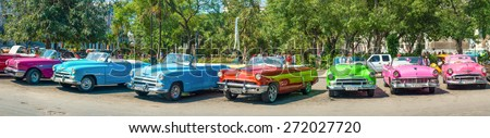 HAVANA,APRIL 3,2015 : Group of colorful vintage cars parked in Old Havana - stock photo
