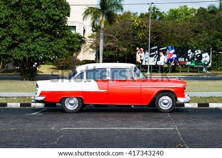 HAVANA - APRIL 27: Old colourful cars in Havana, Cuba on April 27, 2016 - stock photo