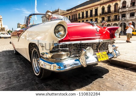 HAVANA-AUGUST 14:Vintage Ford Fairlane in front of the Capitol August 14,2012 in Havana.These old cars,the only ones that could be bought until a recent law in 2011,have become a symbol of the city - stock photo