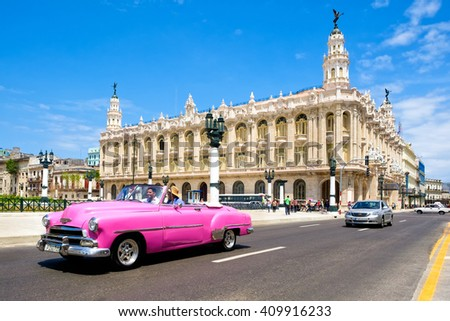 HAVANA,CUBA- APRIL 20,2016 :  Classic vintage car next to the beautiful Great Theater of Havana on a clear sunny day