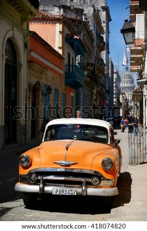 Havana, CUBA - APRIL 7, 2016: Havana, old classic American car on street of Havana,CUBA. Cuba cars in Havana. Cuba, Havana historic.  Editorial photo. - stock photo