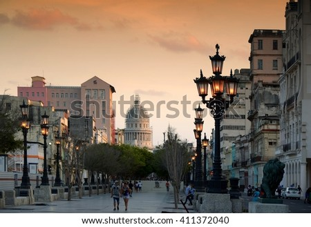 Havana, CUBA - APRIL 6, 2016: Sunset in famous Havana, capitol. Havana - street of Havana,CUBA. Cuba - Havana capitol. Cuba, Havana historic. Editorial photo. - stock photo