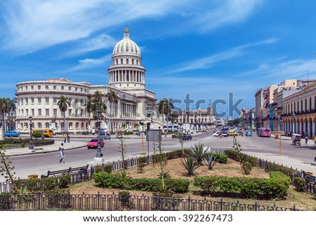 HAVANA, CUBA - APRIL 1, 2012: Taxi bikes and vintage cars in front of Capitolio