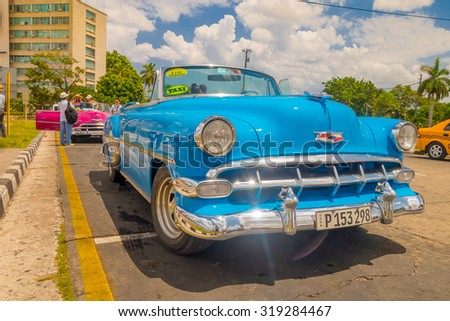 HAVANA, CUBA - AUGUST 30, 2015: Old classic American cars used for taxi and tourist transportation. Before a new law issued on October 2011, cubans could only trade cars that were on the road before