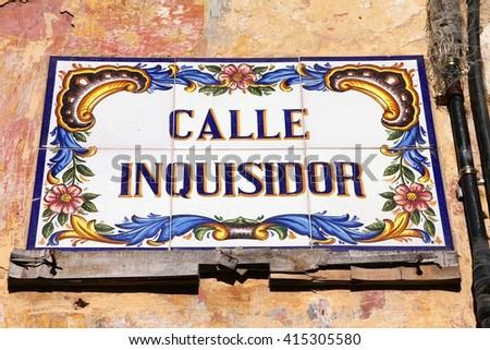 Havana, Cuba - ceramic street sign at Calle Inquisidor - stock photo