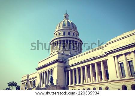 Havana, Cuba - city architecture. Famous National Capitol (Capitolio Nacional) building. Cross processed color tone - retro style filtered image. - stock photo
