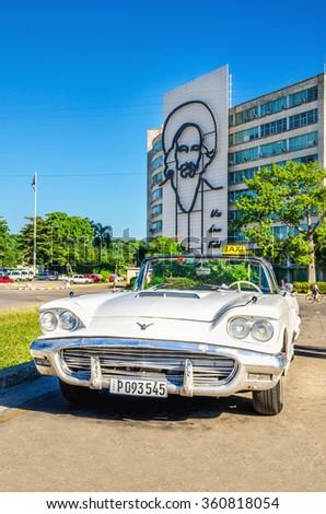 HAVANA, CUBA - DECEMBER 2, 2013: Old classic american white car on the background of Fidel Castro Monument in Plaza de la Revolucion (Revolution Square). in Havana, Cuba - stock photo
