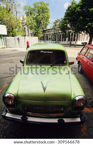 HAVANA, CUBA - FEB 22: Old classic American car park on street of Havana, Cuba on February 22 2008. Old American cars are iconic sight of Cuba street.  - stock photo